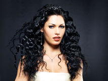 Beautiful fashion woman with curly hairstyle Stock Images