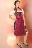 Beautiful fashion, woman in the Dirndl. Beautiful natural model in modern Dirndl costume stock photo