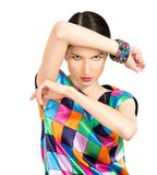 Beautiful fashion woman dressed in colorful checkered dress and Stock Photo