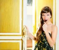 Beautiful fashion woman eating chocolate. In golden door Stock Image