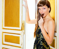 Beautiful fashion woman eating chocolate. In golden door Royalty Free Stock Photo
