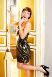 Beautiful fashion woman eating chocolate. In golden door Stock Photography