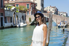 Beautiful fashion woman with hat   in Venice, Italy. Happy young woman  enjoying the view in venice, italy Stock Image