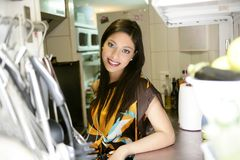 Beautiful fashion woman on the kitchen Stock Image