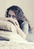 Beautiful fashion woman with long curly hairs in a bedroom Stock Photo