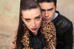 Beautiful fashion woman looking at the camera. Close up picture of a young beautiful fashion women looking at the camera while her lover is holding her from the Royalty Free Stock Image