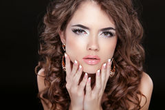 Beautiful fashion woman with makeup, long wavy hair and manicure. D nails isolated on black background Royalty Free Stock Photos