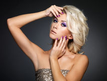 Beautiful fashion woman with manicure and makeup Royalty Free Stock Photos