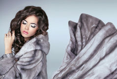 Beautiful fashion woman in mink fur coat. Winter girl in luxurio Royalty Free Stock Images