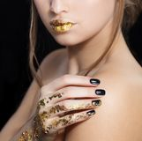 Beautiful Fashion woman model face portrait with gold lipstick and black nails. Glamour girl with bright makeup. Beauty. Female. Perfect skin and make up. Nail stock image