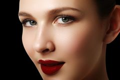 Beautiful fashion woman model face portrait with red lipstick. G Royalty Free Stock Photo