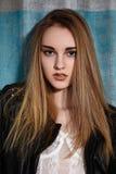 Beautiful fashion woman model in rock leather jacket, dark make-up. Street fashion look. Long hairstyle, straight hair. Beautiful fashion portrait of woman model stock image