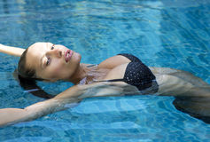 Beautiful fashion woman in pool. Sexy girl with Royalty Free Stock Images