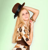 Beautiful fashion woman portrait with brown hat Stock Images