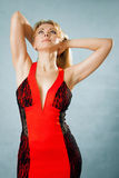Beautiful fashion woman posing in red dress Stock Photography