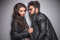 Beautiful fashion woman pulling her boyfriends jacket Royalty Free Stock Image