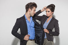 Beautiful fashion woman pulling her lovers jacket Royalty Free Stock Photos