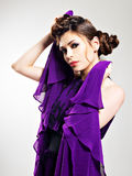 Beautiful fashion woman in purple long dress Stock Images
