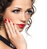 Beautiful fashion woman with red manicure and lips Stock Photos