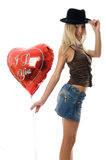 Beautiful fashion woman  with a red party balloon. Royalty Free Stock Photos