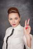 Beautiful fashion woman showing victory sign Royalty Free Stock Photos