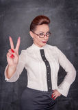 Beautiful fashion woman showing victory sign Royalty Free Stock Photography