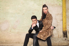Beautiful fashion woman sitting on her boyfriend lap Stock Image