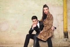 Beautiful fashion woman sitting on her boyfriend lap Stock Image