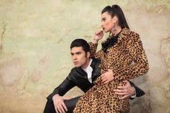 Beautiful fashion woman sitting on her boyfriend's lap Stock Photo