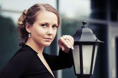 Beautiful fashion woman standing at lamppost Stock Photography