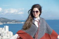 Beautiful fashion woman with sunglasses  on a sea background Royalty Free Stock Images
