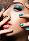 Beautiful fashion woman with turquoise make-up Stock Photography