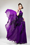 Beautiful fashion woman in violet long dress Stock Photo