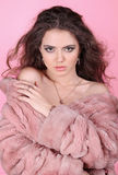 Beautiful fashion woman wearing a fur coat Stock Photo