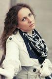 Beautiful fashion woman in white coat walking outdoor Royalty Free Stock Image
