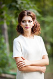 Beautiful fashion woman in white shirt in park Stock Photos