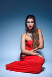 Beautiful fashion young woman in red dress Royalty Free Stock Photo