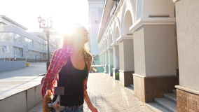 Beautiful and fashion young woman with a skateboard stock footage