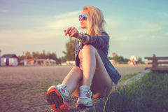 Beautiful fashion young woman sunglasses sitting Royalty Free Stock Photos