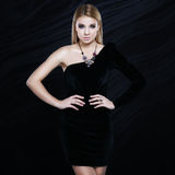 Beautiful fashionable blonde in a black dress Royalty Free Stock Image