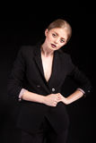 Beautiful fashionable blonde lady in suit on black background Royalty Free Stock Images