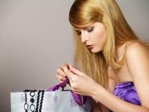 Beautiful fashionable girl considers gifts Stock Image