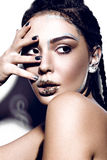 Beautiful fashionable girl with creative glitter make-up, hairstyle braids and sparkles on the lips. beauty face. Royalty Free Stock Images