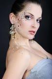 Beautiful fashionable girl on dark background with diamond Stock Photos