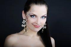 Beautiful fashionable girl on dark background with diamond Royalty Free Stock Image