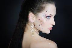Beautiful fashionable girl on dark background with diamond Royalty Free Stock Photography