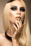 Beautiful fashionable girl in a glamorous image Royalty Free Stock Photo