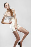 Beautiful fashionable girl in glamour dress Royalty Free Stock Photos