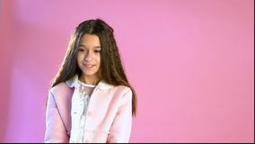 Beautiful fashionable girl poses on a pink background stock video