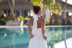 Beautiful fashionable girl on summer vacation royalty free stock photography